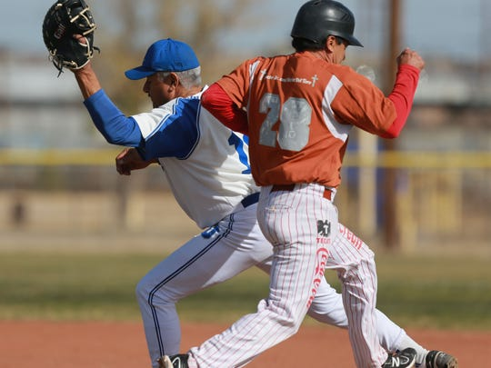 Ramon Serna, left, put out Cruz Arciniega at first base duiring a recent game.