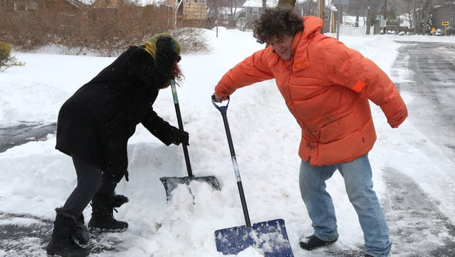 Jane Fuller and Steve Vavagiakis clear their driveway in Blauvelt on March 14, 2017.