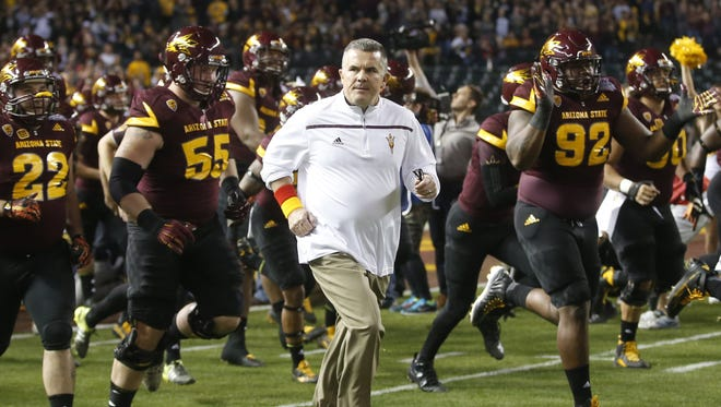 Arizona State head coach Todd Graham takes the field during the Cactus Bowl against West Virginia at Chase Field in Phoenix on January 2, 2016.