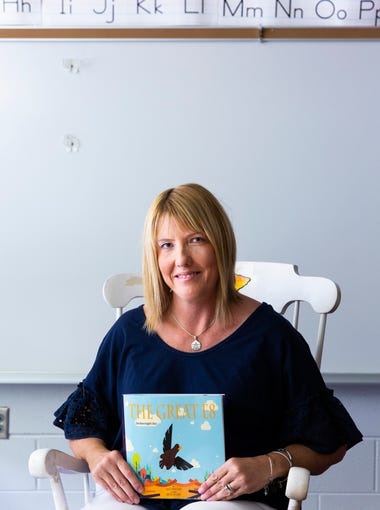 """Traci Bratcher holds her new children's book, """"The"""