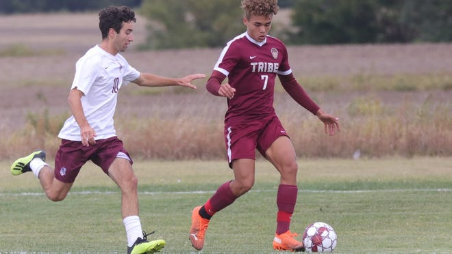 Hays High's Diego Muller controls the ball as Salina Central's Nolan Foley defends on Thursday at Hays High. Salina Central won 2-1 in two overtimes.