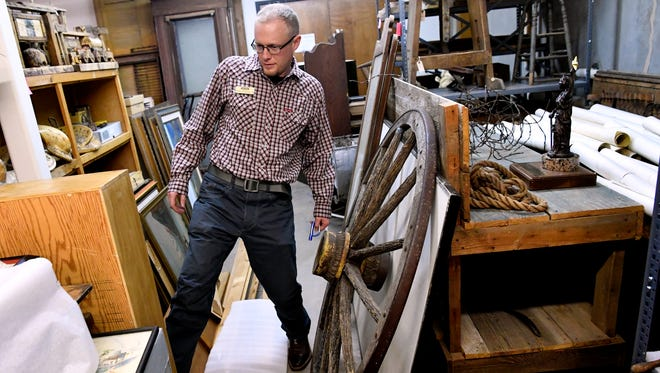 Daniel Schlegel, Jr. steps around some of the larger items in the basement of the Scurry County Museum on Feb. 7. After eight years in Snyder, Schlegel is taking a new job at the Colorado School of Mines Geology Museum.