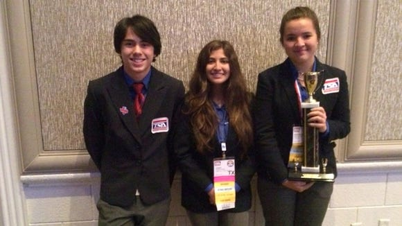 Chapin High School students (from left) Lertchaai Hale, Celeste Casarez and Sarah Willis earned first place in the children's story competition at the national Technology Students Association conference last week.