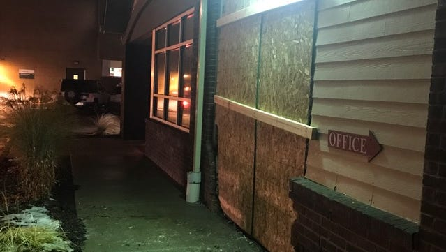 A driver ran into the Ele's Place building and five cars on Wednesday in Lansing.