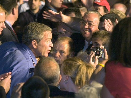 President George Bush moves into the crowd after his speech at the York Expo Center in 2004.  Some people had the opportunity to shake his hand.  'It was a once-in-a-lifetime opportunity.' York City Detective Scott Hose said.