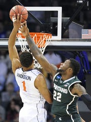 MSU's Branden Dawson blocks a shot by Virginia's Justin Anderson during their NCAA tournament game in March. It was one of four blocks by Dawson in MSU's upset win.