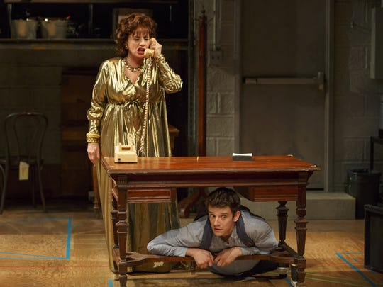 Patti LuPone (left) and Michael Urie perform in a scene