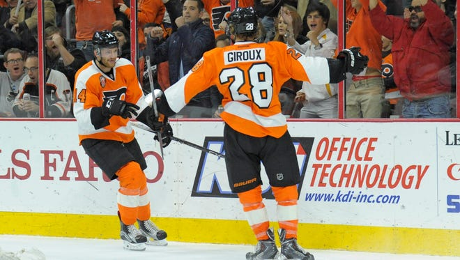 Putting Sean Couturier, left, on a line with Claude Giroux has a big domino effect for the Flyers.