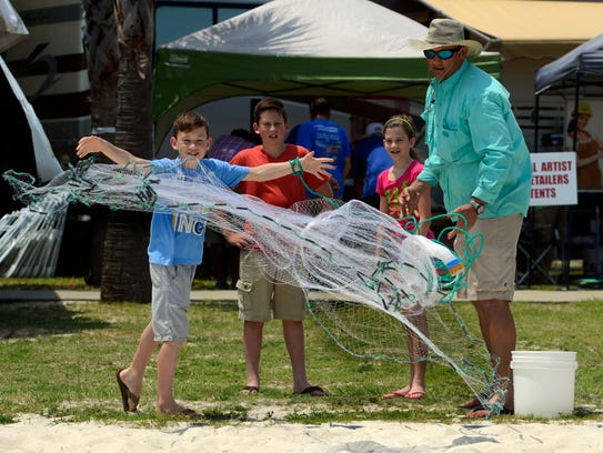 Nathan Webber tosses a cast net as instructor Pete DellaRatta looks on during a previous Gulf Breeze Sertoma Family Fishing Rodeo. Come on down to Shoreline Park South in Gulf Breeze on Saturday and Sunday for this year's event.