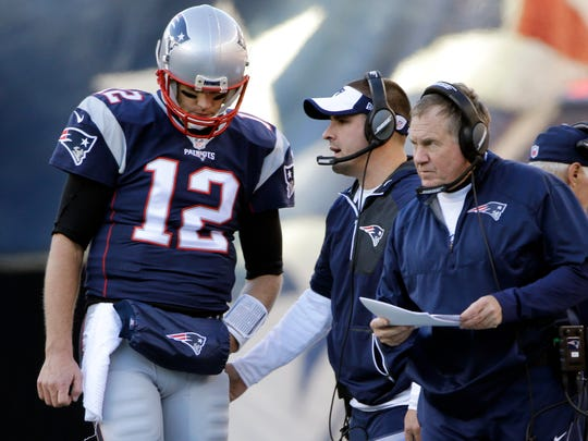 In this Sunday, Dec. 4, 2016, photo, New England Patriots quarterback Tom Brady (12) stands by head coach Bill Belichick during a game against the Los Angeles Rams.