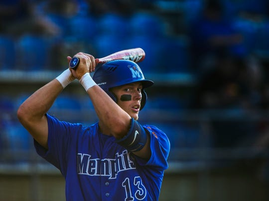 Chris Carrier, a senior right fielder for the University of Memphis, practices his bat swing during a game against Murray State at FedExPark on Tuesday. The baseball player has overcome injuries to lead his team this year.