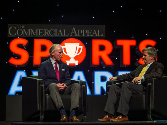 Football great Archie Manning, left, speaks on stage