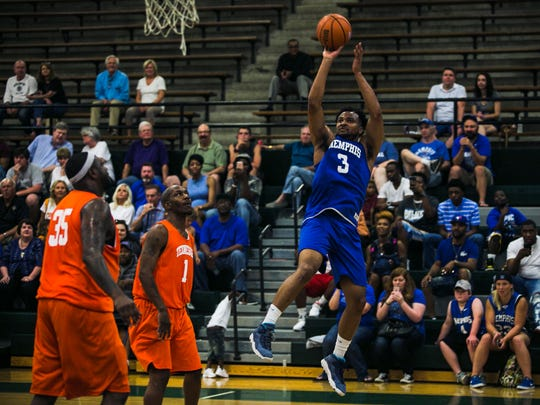 June 24, 2017 - Former University of Memphis basketball player Chris Crawford (3) shoots a basket during the Memphis-Tennessee alumni basketball game at White Station High School on Saturday.