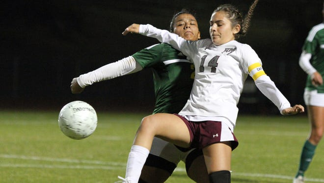 Rancho Mirage's Melina Flores, right, and Coachella Valley's Itzel Candido battle for the ball during the game in Rancho Mirage on Thursday, January 19, 2017. Rancho Mirage won.