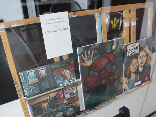 Shoppers in downtown Westfield can enjoy art creations such as these during Youth Art Month in March, when paintings, drawings and sculpture designed by approximately 300 students from Westfield's 10 public schools are on display in merchants' windows.