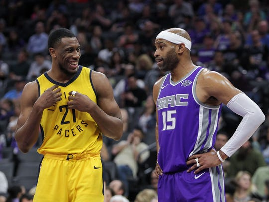 Indiana Pacers forward Thaddeus Young (21) laughs with Sacramento Kings guard Vince Carter (15) during the first half at Golden 1 Center.