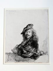A Rembrandt etching titled, Self Portrait Leaning