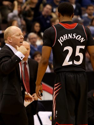 UC guard Kevin Johnson is one of four players that coach Mick Cronin, left, say will be a big factor at the end of close games.