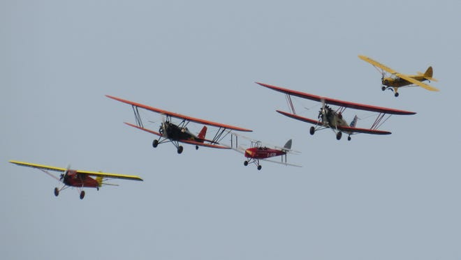A formation of aircraft is shown during one of the shows at the Old Rhinebeck Aerodrome.  Pitcutred, from left to right, are 1928 Curtiss Robin, 1929 New Standard D-25, 1941 DeHavilland Tiger Moth, 1929 New Standard D-25 and 1938 Piper J-3 Cub.
