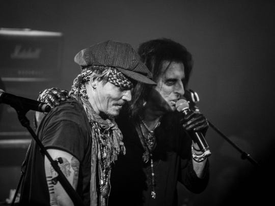 Hollywood Vampires perform during Alice Cooper Christmas Pudding at Celebrity Theatre on Dec. 3, 2016 in Phoenix. The band included Joe Perry of Aerosmith and actor Johnny Depp on guitar.