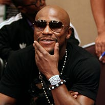 Jul 14, 2014; New York, NY, USA;  Floyd Mayweather Jr. reacts to questions from media at the Marriott Marquis in Times Square. Mandatory Credit: Noah K. Murray-USA TODAY Sports