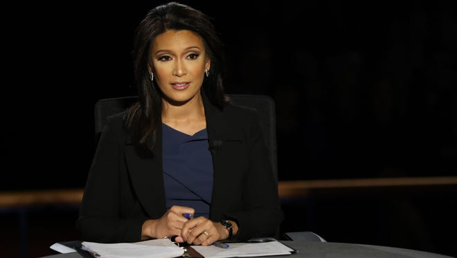 Moderator Elaine Quijano from CBS reads her notes before the first vice presidential debate at Longwood University in Farmville, Va. on Oct. 4, 2016.