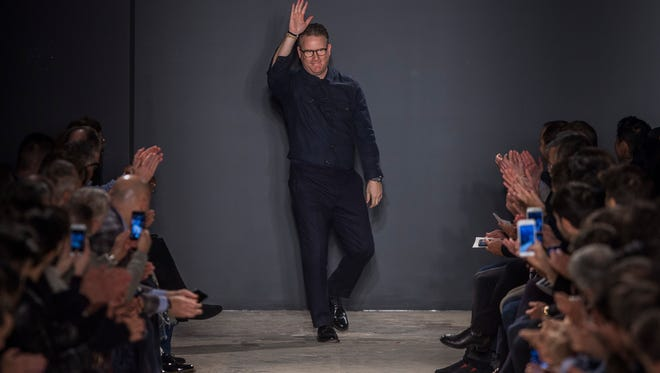 Designer Todd Snyder waves after the presentation of his men's collection during Men's Fashion Week in New York, Wednesday, Feb. 1, 2017.