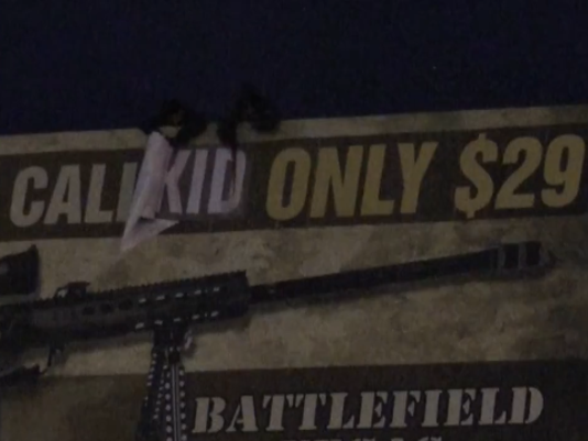 INDECLINE 'Shoot a kid' vandalized billboard