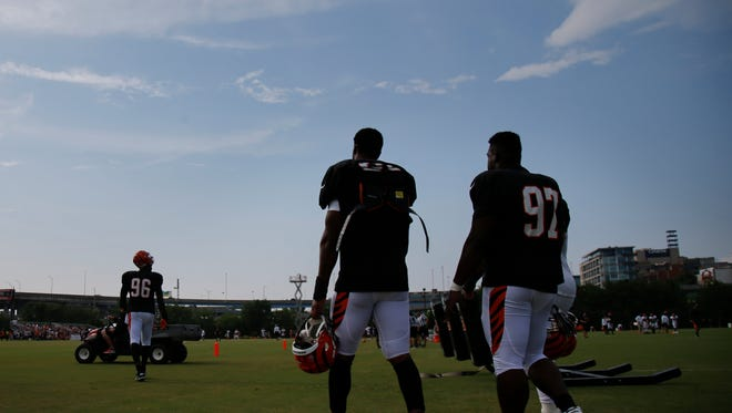 Bengals defensive linemen Michael Johnson (90) and Geno Atkins take the field during training camp on Aug. 5.