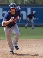 Jason Kanzler runs safely towards third base during