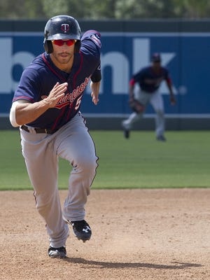 Jason Kanzler runs safely toward third base during an April game at Century Link Sports Complex in Fort Myers. He scored a run during the inning.