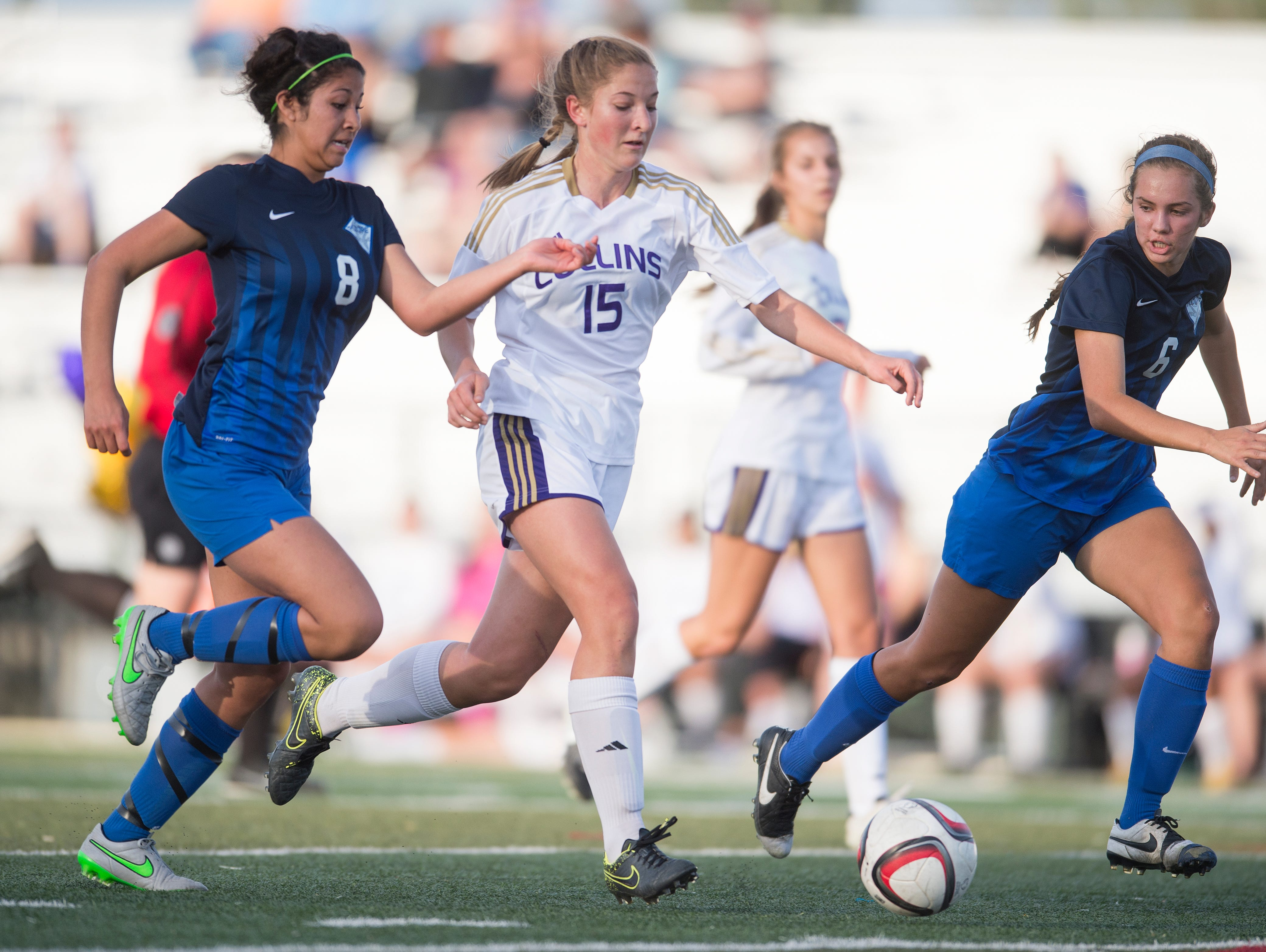 Esther Malers of Fort Collins High School tries to get around Poudre defenders Shea Sarmiento and Scout Bohlender during a game at French Field Thursday, May 5, 2016. The Lambkins defeated the Impalas 3-0.