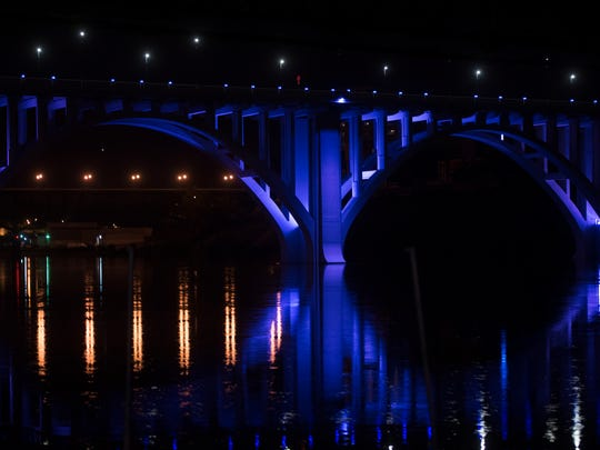 "The Henley Bridge, as seen from Neyland Drive, is lit up in blue to cheer on Knoxville worship leader Chris Blue for his performance in the season finale of ""The Voice"" on Tuesday, May 23, 2017."