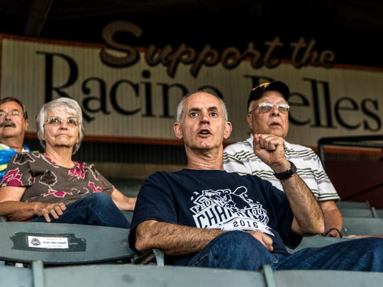 Allen Weinbach watches the Otters play against the Florence Freedom with other host families and booster club members at Bosse Field in Evansville, Ind., on Wednesday, Aug. 9, 2017. Weinbach, who has been hosting players at his home since 2000, comes to nearly every single home game.
