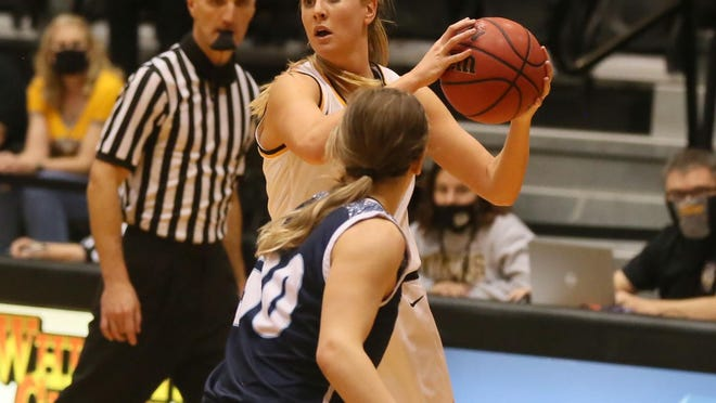 Fort Hays State's Whitney Randall looks to pass during the Tigers' season opener vs. Washburn.