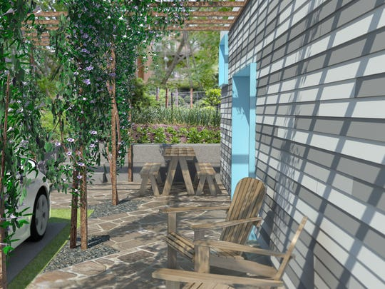 An artist's rendering of what a side yard and patio space may look like at the tiny houses.