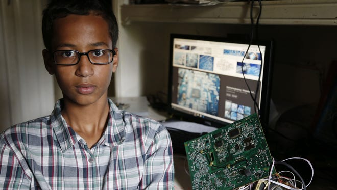 Irving MacArthur High School student Ahmed Mohamed, 14, poses at his home in Irving, Texas. Irving MacArthur High School student Ahmed Mohamed, 14, poses for a photo at his home in Irving, Texas on Tuesday, Sept.  15. Mohamed was arrested and interrogated by Irving Police officers on Monday after bringing a homemade clock to school. Police don't believe the device is dangerous, but say it could be mistaken for a fake explosive. He was suspended from school for three days, but he has not been charged.