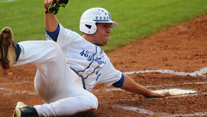 Highlands' Todd Ramey slides safely home during the Bluebirds' state quarterfinals game against North Bulitt Wednesday.