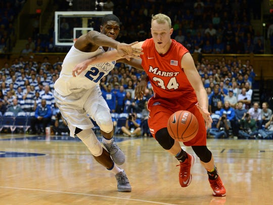 Marist College's David Knudsen drives past Duke's Amile Jefferson during a game at Cameron Indoor Stadium in Durham, North Carolina last season.