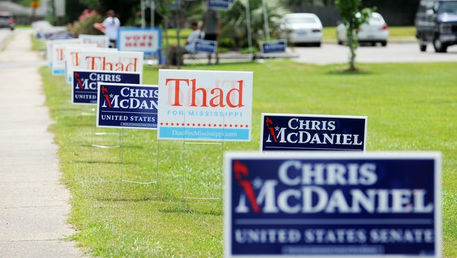 Campaign signs line Jamestown Road in front of Thames Elementary School Tuesday during the Republican primary runoff election between six-term incumbent Thad Cochran and challenger Chris McDaniel.