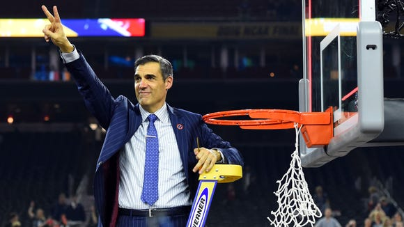 Apr 4, 2016; Houston, TX, USA; Villanova Wildcats head coach Jay Wright gestures to the crowd as he cuts down the net after defeating the North Carolina Tar Heels in the championship game of the 2016 NCAA Men's Final Four at NRG Stadium. Mandatory Credit: Robert Deutsch-USA TODAY Sports