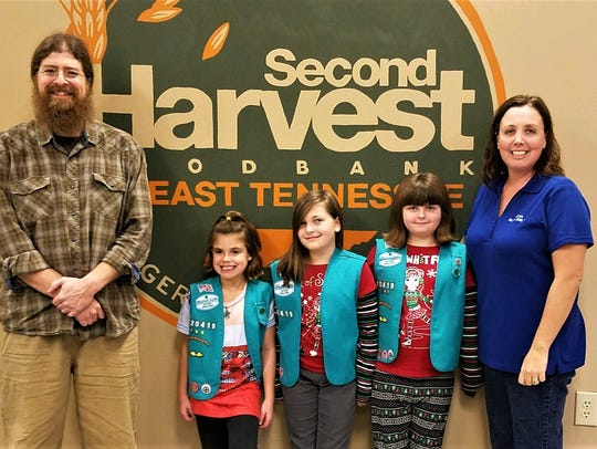 Volunteer Sam Compton helped Savannah Bush, Addie Havely,