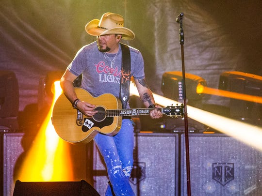 Jason Aldean and his band perform at the Country Thunder