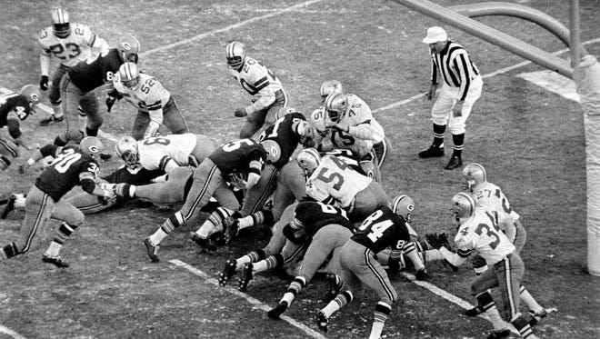 Bart Starr sneaks into the end zone for the winning touchdown in the Green Bay Packers' 21-17 victory over the Dallas Cowboys in the NFL Championship Game, better known as the Ice Bowl, on Dec. 31, 1967.