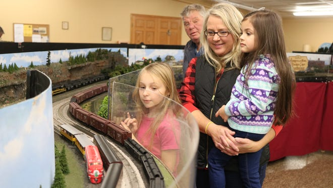 Kailyn Bischoff, 8, Denise Workman and Avery Beccera, 5, of Clyde, check out the model train display at the Winesburg Christmas Weekend.