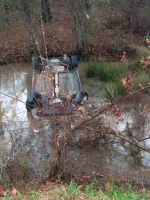 """The vehicle of Chasity White sits in a ditch shortly after the accident in which her daughter, Helena White, was trapped in the freezing water for """"more than 10 minutes."""""""