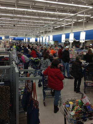 Hundreds of shoppers crowded the aisles of local grocery stores as a winter storm bore down on south-central Michigan, including the Meijer store on Beckley Road.
