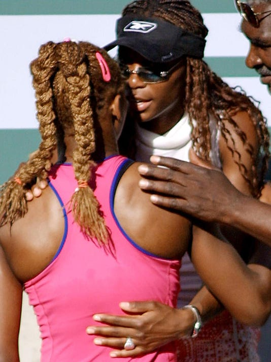 Serena Williams (L) is congradulated by her siste