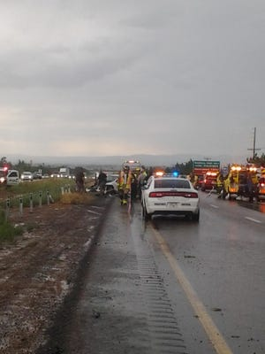 Law enforcement officials investigate the scene of an accident July 6. A black passenger car careened out of control striking Utah Highway Patrol Trooper David Schiers resulting in serious injuries.