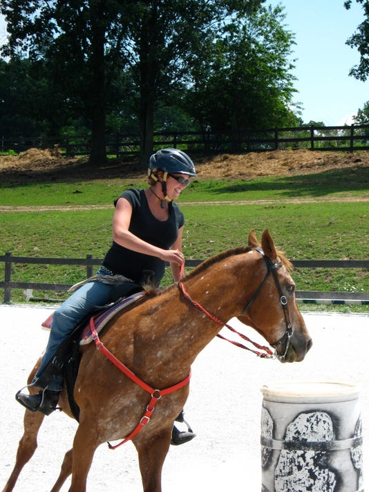 Danielle Knell races around a barrel in one of the games that is used in the fundraiser. PHOTO SUBMITTED